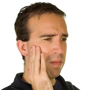 Почему болит челюсть?